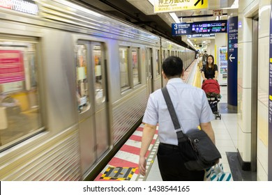 Tokyo, Japan - May 11, 2019:Passengers walking on platform subway station in Tokyo, Japan. Rail transport in Japan is a major means of passenger transport.