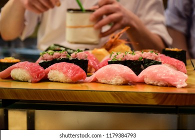 TOKYO, JAPAN - MAY 12, 2018: Japanese chef serving Japanese food style set of Sushi in a restaurant