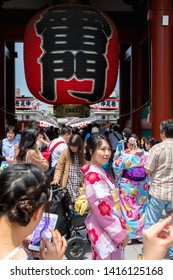 TOKYO, JAPAN - MAY 12, 2019 : Tourist woman capture in Kaminarimon Gate of Sensoji temple. Sensoji temple is the most famous temple in Asakusa, Tokyo prefecture, Japan.