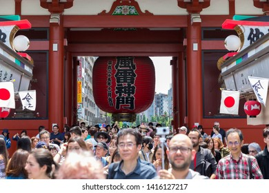 TOKYO, JAPAN - MAY 12, 2019 : Many tourist in Kaminarimon Gate of Sensoji temple. Sensoji temple is the most famous temple in Asakusa, Tokyo prefecture, Japan.