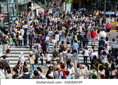 TOKYO, JAPAN - MAY 12, 2019 :Crowd of people crossing the street in Shibuya Ward area Tokyu Plaza Omotesando shopping , Tokyo, Japan