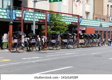 Tokyo, Japan - May 12, 2019:Row of Japanese rickshaws parking at the sidewalk on Asakusa road, the rickshaw is popular among the tourists visiting Japan for sightseeing around travel attraction