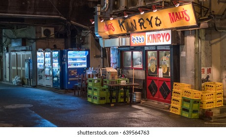 TOKYO, JAPAN - MAY 13TH, 2017. Back alley street gastro pub or locally know as izakaya in Ginza. An izakaya is a type of informal Japanese gastro pub and are casual places for after-work drinking.
