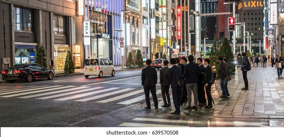TOKYO, JAPAN - MAY 13TH, 2017. Japanese white-collar worker or salaryman in Ginza. Salaryman refers to a man whose income is salary based, particularly those working for corporations for long hours.