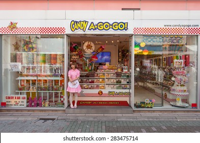 Tokyo, Japan - May 14, 2015: Candy a go go candy shop and vendor at Harajuku's Takeshita street, known for it's Colorful shops and Punk Manga - Anime overall look.
