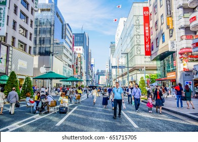 TOKYO, JAPAN - MAY 15: People spending their time visiting Ginza street, a very popular shopping area of Tokyo, during weekend
