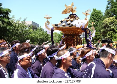 Tokyo, Japan - May 17, 2014:Sanja Matsuri is one of the 3 great Shinto festivals in the Asakusa district of Tokyo, JAPAN. People are carrying a mikoshi (portable shrine) at Sanja Matsuri in Asakusa