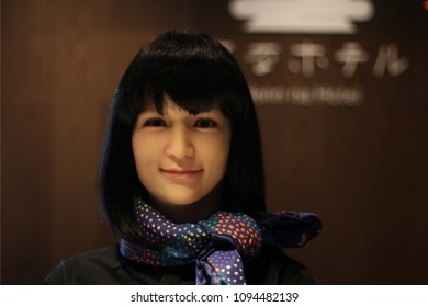TOKYO, JAPAN - May 17, 2018: A robot receptionist working on the reception desk of a Henn Na Hotel in Ginza. The hotel uses a variety of robots and is owned by H.I.S. hotel chain. Shallow depth of