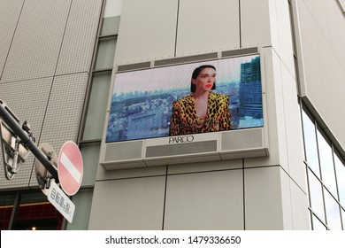 TOKYO, JAPAN - May 17, 2019: A screen on the wall of a Parco department store in Tokyo's Taito Ward. It has a video of singer St. Vincent which is part of a collaboration between her & the company.