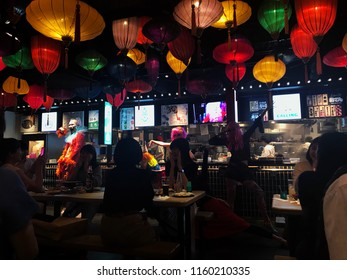 Tokyo, Japan - May 18, 2018: A restaurant in Shinjuku District decorated by many colourful lanterns, many of young asian people sitting around having dinners and enjoying the show