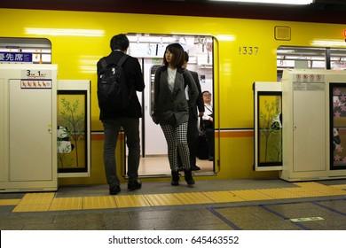 TOKYO, JAPAN - May 19, 2017: The platform screen doors are open as passengers board and alight a subway train at a Ginza Line platform at Tokyo Metro's Ueno Station.