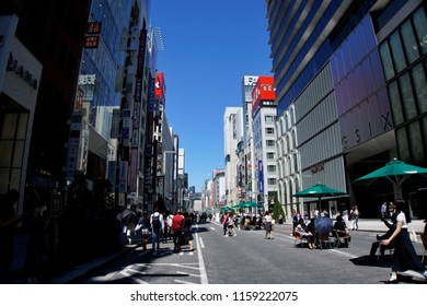 Tokyo, Japan - May 20, 2018: perspective day view of Ginza street one of the most popular shopping areas in Tokyo with a number of people walking and chilling along the street