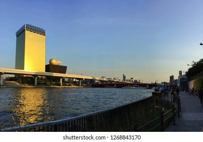 TOKYO, JAPAN - May, 2016: View of Sumida river with Asahi Beer Hall at Asakusa, landmark of old town popular tourist spot in Japan.