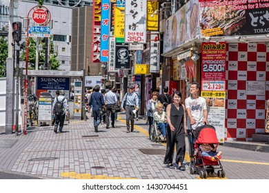 Tokyo, Japan - May 24, 2019: People go for a walk in the famous Shinjuku neighborhood. More than three hundred thousand people live in Shinjuku.