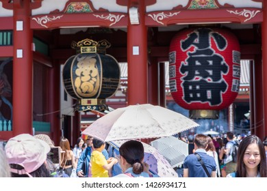 Tokyo, Japan - May 25, 2019: A crowd of people view Kaminarimon or Thunder Gate at the beautiful Senso-Ji Shrine, in Asakusa, an area known for the shrine and its traditional, historic architecture.