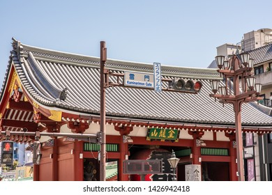 Tokyo, Japan - May 25, 2019: Street sign marking the beautiful Kaminarimon, or Thunder Gate, at the entrance to the Senso-ji Shrine, in Asakusa, an area known for the shrine and historic architecture.