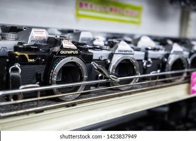 Tokyo, Japan - May 26 2016: Various 35mm camera bodies at a used camera store.