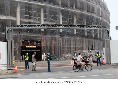 TOKYO, JAPAN - May 26, 2018: View of an entrance to the under-construction Kengo Kuma-designed 2020 Tokyo Olympic Stadium. Some motion blur.