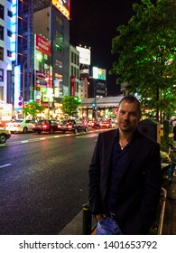 TOKYO, JAPAN - MAY 29, 2015: Tourist in the Roppongi district by night.