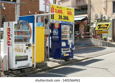 TOKYO, JAPAN - May 3, 2019: A pair of drinks vending machine on the edge of a 24 Times 24-hour car park in in Tokyo's Kagurazaka area.