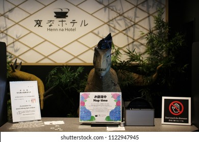 TOKYO, JAPAN - May 30, 2018: A dinosaur robot receptionist, one of a pair, on the reception desk of a Henn Na Hotel in Kasai. The hotel uses a variety of robots and is owned by H.I.S. hotel chain.