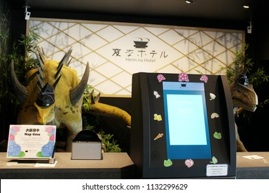 TOKYO, JAPAN - May 30, 2018: A pair of Dinosaur robots working on reception desk of a Henn Na Hotel in Kasai. The hotel uses various robots & is owned by H.I.S. hotel chain. Shallow depth of field.
