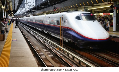 TOKYO, JAPAN - MAY 4, 2012: Travelers board Shinkansen Hayate train on May 4, 2012 at Tokyo Station. Hayate has top operating speed of 275km/h and is among fastest trains worldwide.
