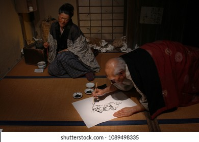 TOKYO, JAPAN - May 4, 2018: View of an animatronic exhibit featuring animatronic figures of the painters Hokusai and his daughter Oei at the Sumida Hokusai Museum.