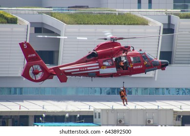 TOKYO, JAPAN - MAY 4TH 2016. An SA 365 Dauphin 2 helicopter from the Tokyo Fire Department puts on a display for the public in Tokyo Bay.