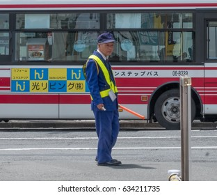 TOKYO, JAPAN - MAY 4TH, 2017. Elderly security guard in Tokyo, Japan. People aged 65 and over in Japan are more likely to work than in any other developed country.