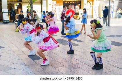 Tokyo, Japan - May 5, 2015: Young Japanese girl group performs a routine outside Akihabara station in Tokyo.