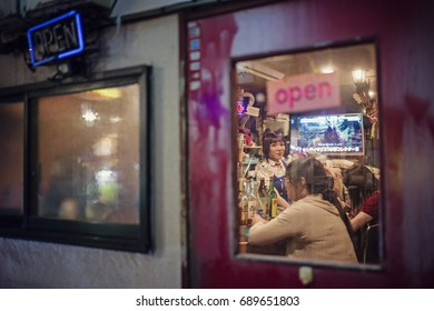 Tokyo, Japan - May 5 2017: The famous Golden Gai with Neon light at night in Shinjuku. Full of restaurants and bars in the neighborhood.