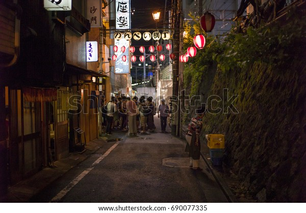 Tokyo, Japan - May 5 2017: The famous Nonbei Alley with Neon light at night in Shibuya district. Full of restaurants and bars on this short alley.