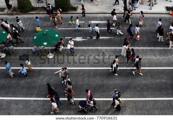 TOKYO, JAPAN - May 5, 2017: Overhead view of the busy street in front of the Ginzasix shopping mall. It's a so-called 'pedestrian paradise day' so there are no cars are on the road.