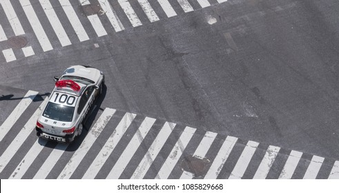 TOKYO, JAPAN - MAY 5TH, 2018. Aerial view of Japanese police car on the road in Shibuya.