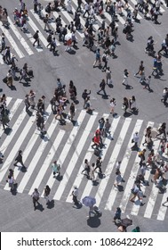 TOKYO, JAPAN - MAY 5TH, 2018. Aerial view of pedestrian walking  to cross the famous Shibuya scramble crossing.