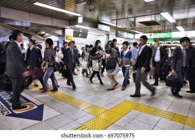 TOKYO, JAPAN - MAY 9, 2012: Crowds hurry at Tokyo Shibuya station in Japan. With 2.4 million passengers on a weekday, it is the 4th-busiest commuter rail station in Japan.