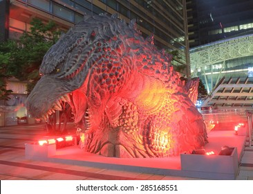 TOKYO JAPAN - MAY 9, 2015: Godzilla statue in Roppongi. Godzilla is a giant monster first appeared in Toho film Godzilla in 1954 and became a worldwide pop culture icon.