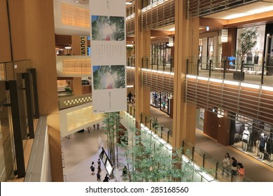 TOKYO JAPAN - MAY 9, 2015: Unidentified people visit Modern Roppongi Midtown complex. Roppongi is famous as home to the rich Roppongi Hills and active night club scene in Tokyo.