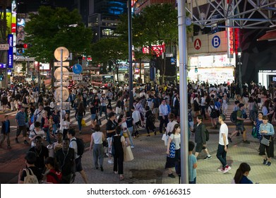 Tokyo, Japan - May 9 2017: People crossing street in a busy street in Shibuya at night.