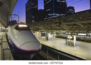 TOKYO, JAPAN - NOV 22: JR East Shinkansen ready to depart at Tokyo Station, on November 22, 2014, in Tokyo, Japan. Shinkansen also known as the Bullet Train celebrates 50 years in 2014.