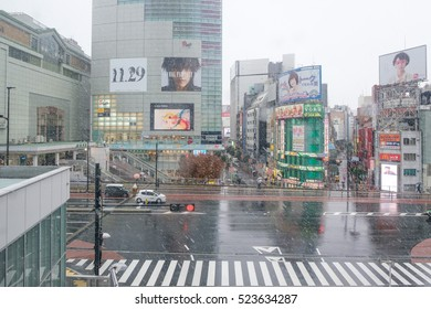 Tokyo, Japan - Nov 24, 2016: Stores near Shinjuku Station in snowy day.It is the first time in 54 years to have snow in November in Kanto area.