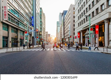TOKYO, JAPAN - NOV 5: People are crossing the street in Tokyo during sunset on November 5, 2016.
