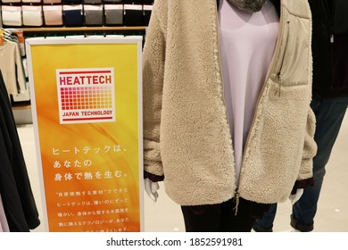 TOKYO, JAPAN - November 11, 2020: Sign for HeatTech clothes and winter clothes on display in Uniqlo Tokyo.