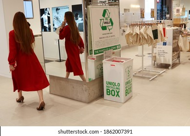 TOKYO, JAPAN - November 11, 2020: Uniqlo Tokyo interior including recycling box for used clothes. SOME MOTION BLUR.