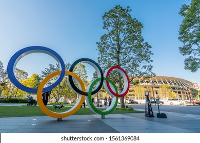 TOKYO, JAPAN - November 1,2019 : The five ring symbol of the Olympic Games at tokyo museum and new stadium in background. Japan will host the Tokyo 2020 summer olympics and Paralympic.