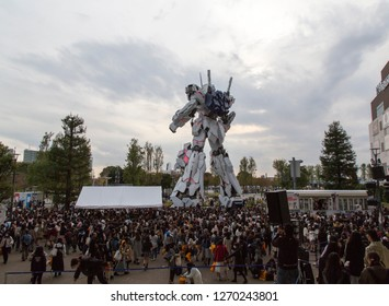 Tokyo, Japan - November 13, 2018: Life Size Unicorn Gundam Statue on the artificial island Odaiba. Gundam is a very famous Japanese animation series, which features giant mecha robots.