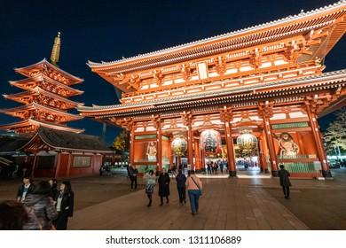 TOKYO, JAPAN - NOVEMBER 14, 2018: Night scene of Sensoji temple with crowded tourist. Sensoji temple is the most famous temple in Asakusa, Tokyo prefecture, Japan