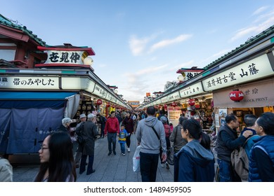 TOKYO, JAPAN - NOVEMBER 14, 2018: Day scene of Sensoji temple with crowded tourist. Sensoji temple is the most famous temple in Asakusa, Tokyo prefecture, Japan