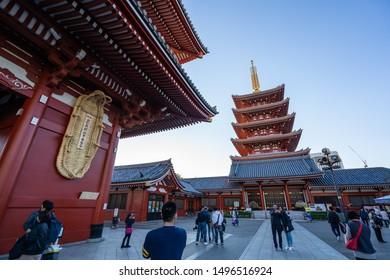 TOKYO, JAPAN - NOVEMBER 14, 2018: Day scene of red pagoda at Sensoji temple. Sensoji temple is the most famous temple in Asakusa, Tokyo prefecture, Japan